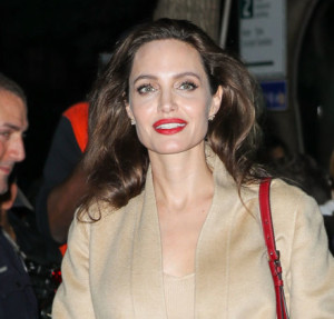 Angelina Jolie was spotted all smiling while leaving AMC Loews Lincoln Square in New York City, NY.   Pictured: Angelina Jolie Ref: SPL1577943  140917   Picture by: Felipe Ramales / Splash News  Splash News and Pictures Los Angeles:	310-821-2666 New York:	212-619-2666 London:	870-934-2666 photodesk@splashnews.com