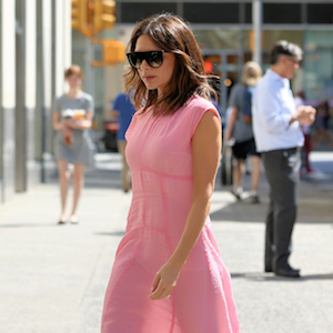 British fashion designer Victoria Beckham, wearing a pink dress from her Spring collection, returns to the Edition Hotel in New York City, New York on June 19, 2018.    Pictured: Victoria Beckham  Ref: SPL5004962 190618 NON-EXCLUSIVE  Picture by: Christopher Peterson / SplashNews.com    Splash News and Pictures  Los Angeles: 310-821-2666 New York: 212-619-2666 London: 0207 644 7656 Milan: +39 02 4399 8577  photodesk@splashnews.com    World Rights